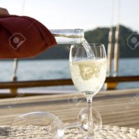 3594074-A-bottle-of-wine-on-the-wooden-deck-of-a-yacht-Stock-Photo