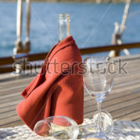 stock-photo-a-bottle-of-wine-on-the-wooden-deck-of-a-yacht-16733479